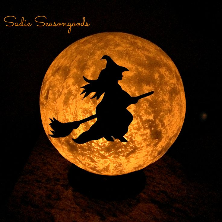 made with an old globe light and craft paint then a flameless candle is added vintage light fixture halloween moon