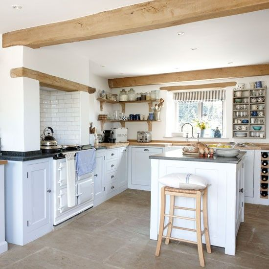 A pale blue scheme gives a light bright feel to this shaker style kitchen with the white AGA and central island unit. http://www.housetohome.co.uk/house-tour/picture/take-a-look-around-this-fabulous-farmhouse-in-the-cotswolds/2
