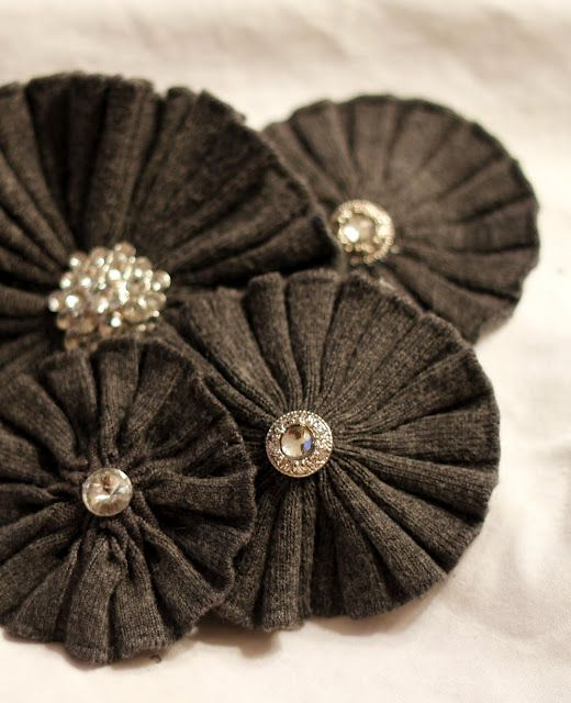 Flower pins made from cuffs of recycled sweaters. Tutorial here: http://fivewhites.blogspot.com/2010/10/sweater-flower-tutorial.html