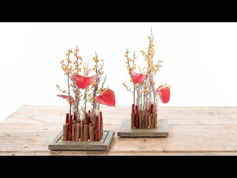 Nelleke Bontje shows you how to make a fun Christmas bouquet. The lovely bright colours and Christmas balls make up for a festive design. Check http://flower...