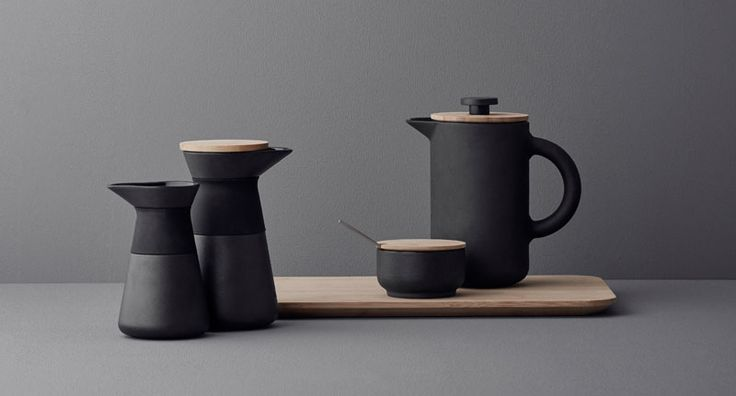 17 Contemporary Coffee Maker Designs That You'll Want To Show Off | With double insulation, this simple matte black French Press with a wooden lid, will keep your coffee warm well into your second cup.