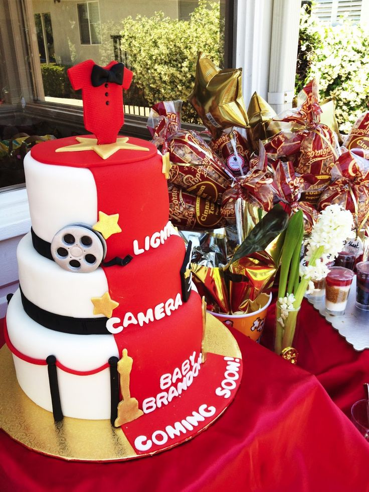 Scenes from a Hollywood-themed Baby Shower Red carpet paparazzi movie production director cast popcornopolis gold star silver screen oscar gold walk of fame vip movie magic film reel red white black glamour glamorous