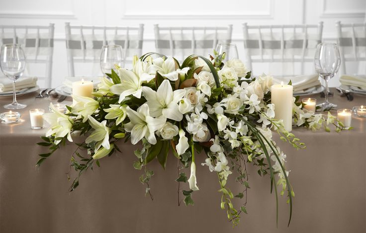 The White Linen arrangement speaks to the true nature of wedding elegance. Description from timclarksflowers.com. I searched for this on bing.com/images