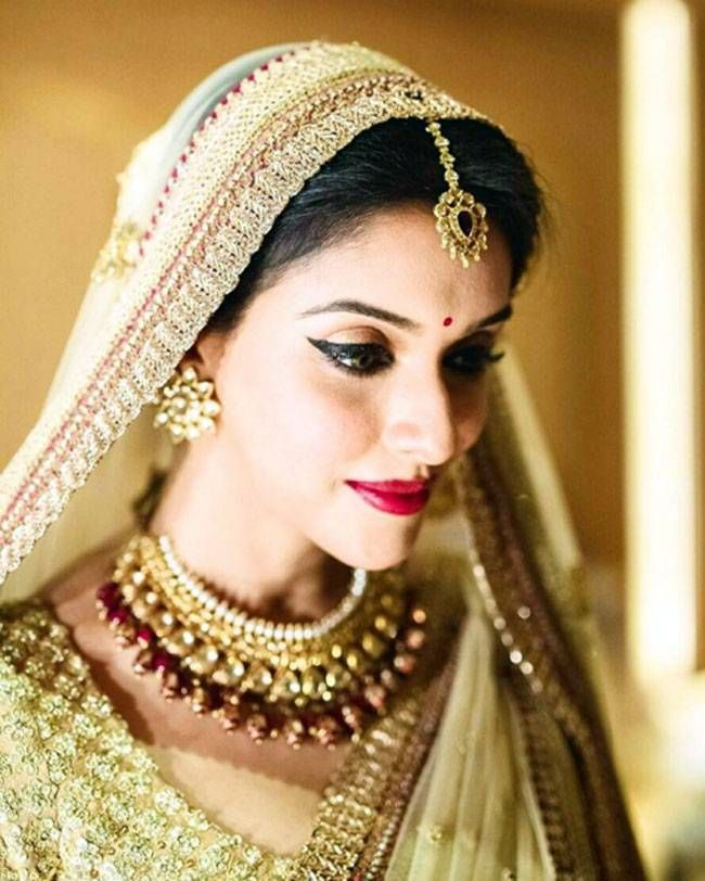 Asin looking beautiful and graceful in her bridal lehenga designed by Sabyasachi.