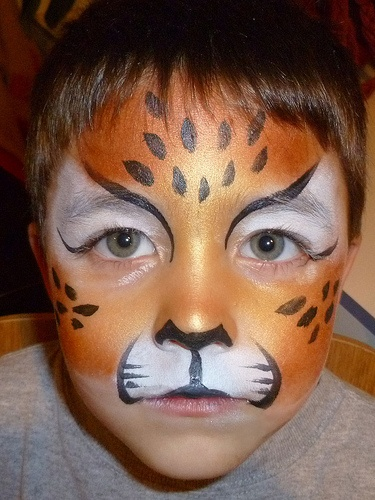 Cheetah face paint.  My son wants a birthday party with a cheetah theme this year.... talk about a weird one.  This looks like a good idea though.