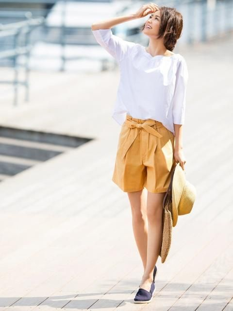 Warm summer hues for a bright, sunny day. Make a statement in our High Rise Belted Shorts.