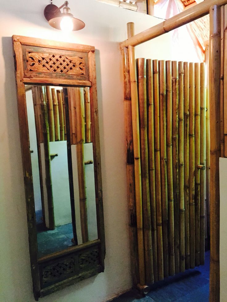 Vintage carved wooden frame used for a mirror at Captain Coconuts Gili Air