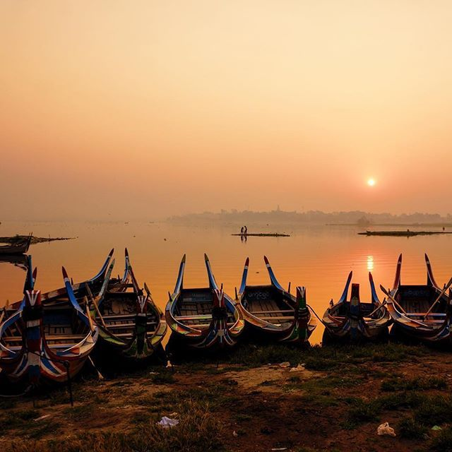 Rows of coloured fisherman boats line the shores of Amarapura's Taungthaman Lake. A visit to this this spot at dawn feels still and quiet, beckoning the start of a brand new day. . . . #myanmar #travelmyanmar #sky_sultans #sky_brilliance #openmyworld #sunrise #wanderlust  #backpacker #instagood #worlderlust #picoftheday #travelingshoot #travelstoke #travel #hiddentravels #beautifulworld #endlesstravelling