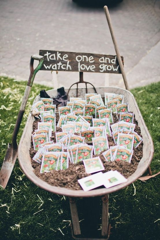 seed packet wedding favors in a wheelbarrow - darlingstuff.info  Hmm interesting something to last beyond the wedding..?