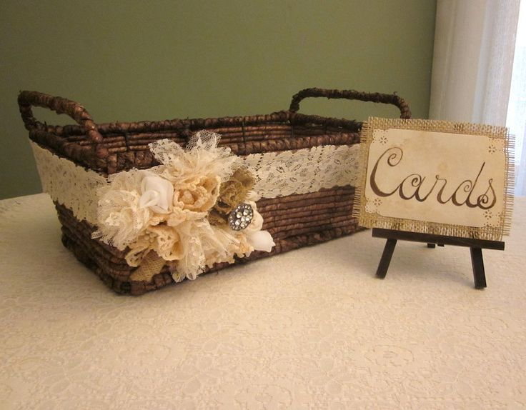 It's not super rustic and I don't know about the bow/flower thingy... But the idea for a card holder is good. You could use a galvanized bucket with a chalkboard or something. I think I pinned something like that for you.