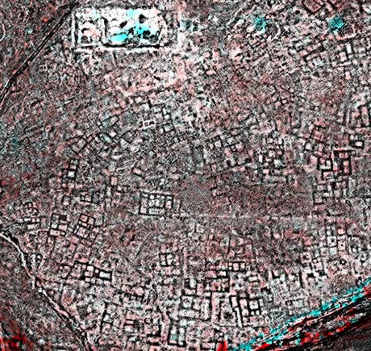 "This image shows the legendary archaeological site of Tanis. As Sarah Parcak puts it drily, ""everyone knows this one from the Bible and Indiana Jones."" While it's difficult to see anything on the ground, the filtered and processed satellite image shows incredible details of digs to be dug."