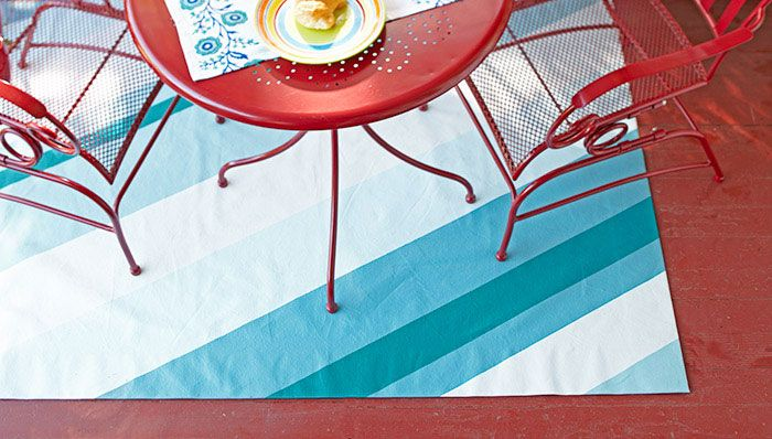 Freshen up a porch or patio with a simple weekend painting project. Turn a drop cloth into a custom-colored rug for a touch of outdoor decor.