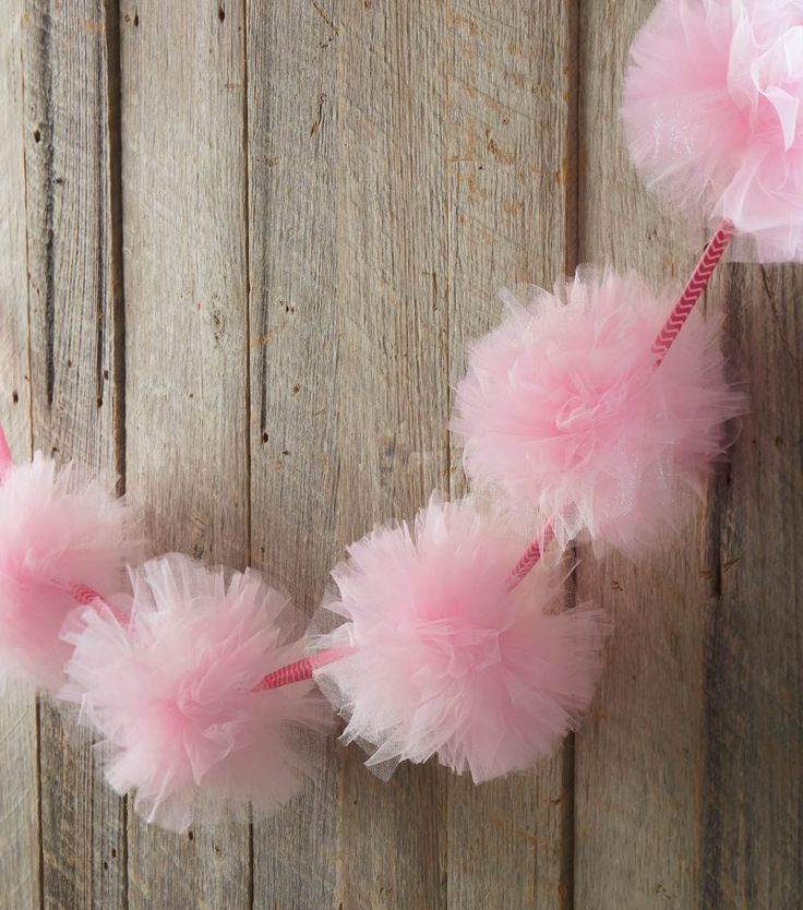 Make your own pretty pink garland from tulle and bring a splash of color to any room or party! Find the instructions on Joann.com!