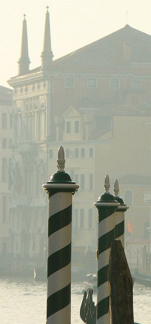 Venezia, Italia - canal pole markers  used for gondolier guidance  for water level.