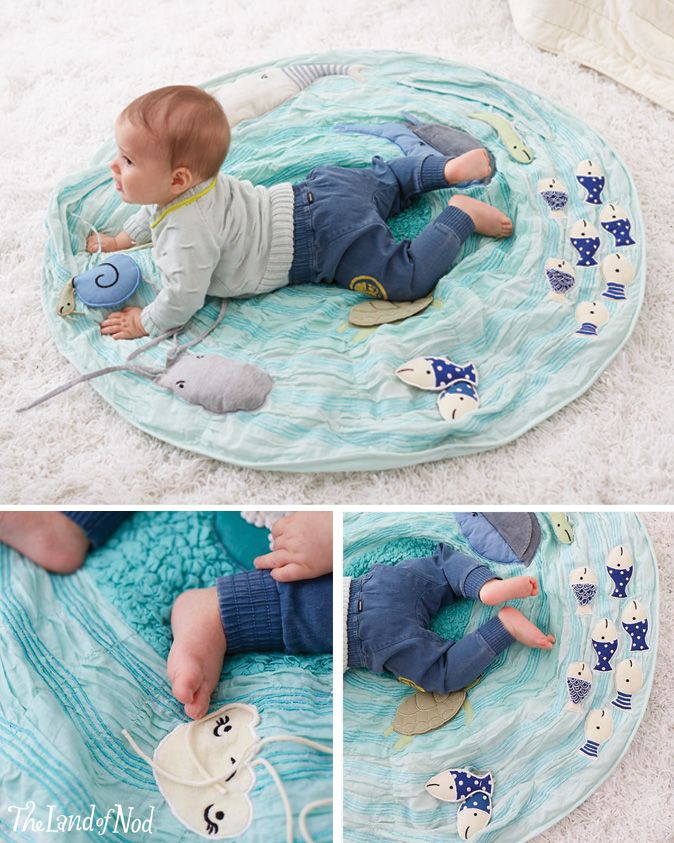 The Land of Nod's marine themed baby activity mat lets your baby explore the wonders of the seven seas from the comfort of the nursery. It features a school of appliqued and embroidered sea creatures, rouched fabric for a wavelike texture and soft padding for extra comfiness. Baby-sized snorkel and fins are not needed.