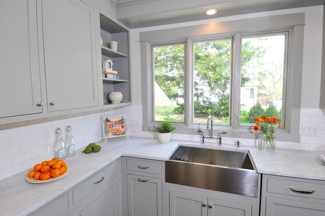 "Benjamin Moore's ""Fieldstone"" gray painted kitchen cabinetry. White carrara marble counters and simple white subway tile backsplash. Vintage style ceiling fixtures and nickel hardware. Cool stainless steel undermount sink with gooseneck faucet.    Benjamin Moore Fieldston"