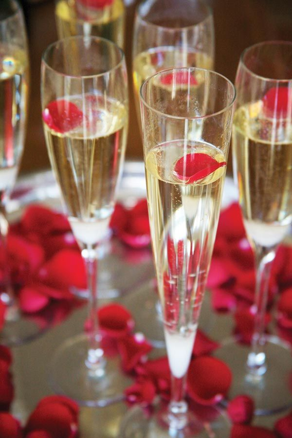 Romantic Fondue Party - Champagne Cocktails garnished with rose petals... so easy and romantic!