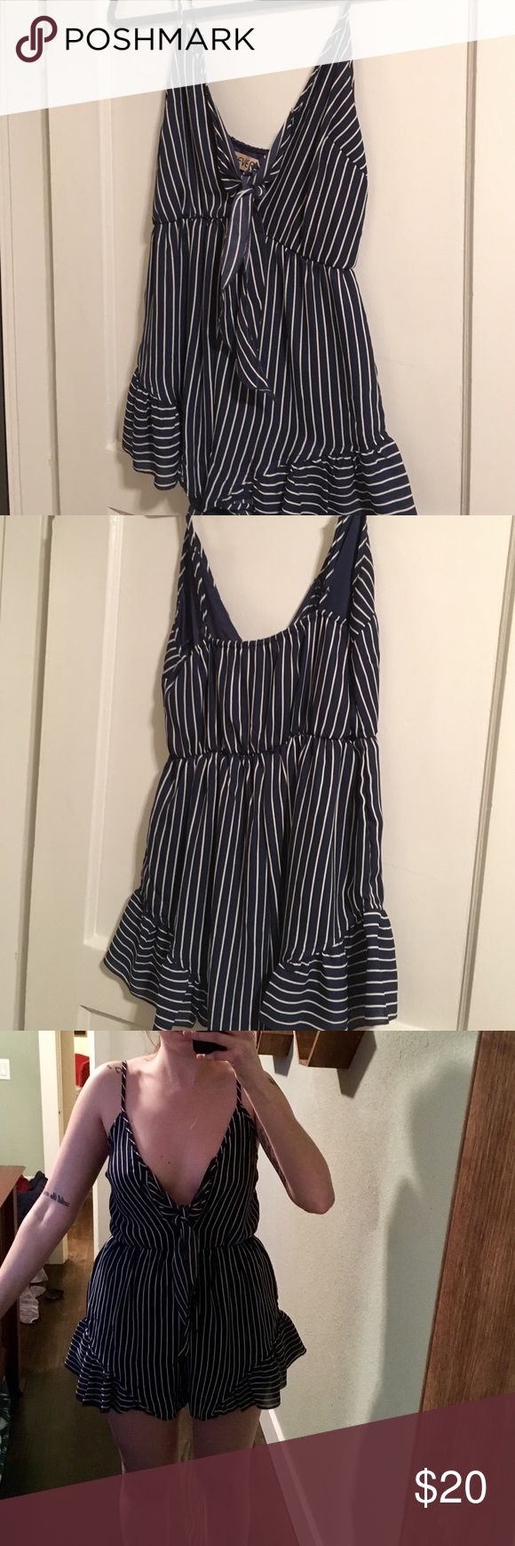 Tie-front striped romper Worn only once! This is from the Australian online boutique Princess Polly by a brand called Reverse. Elasticated waist and ruffled short. Low plunging front with keyhole where it's tied. Looks great with some wedges and layered with a cute bralette underneath (see last photo)! 100% polyester. Pants Jumpsuits & Rompers