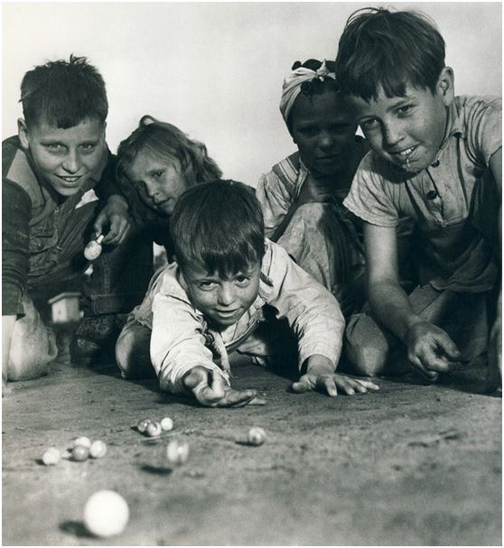 I loved watching my brother and his friends play marbles.  The marbles were so pretty.