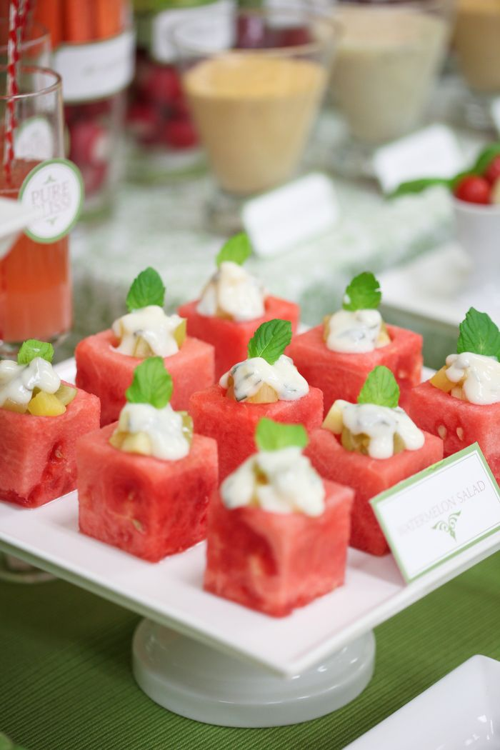 """Watermelon Salad"" watermelon cut into square cubes with a small round hole carved on top, which was filled with a combination of diced grapes and apple & dressed with a yogurt dressing"