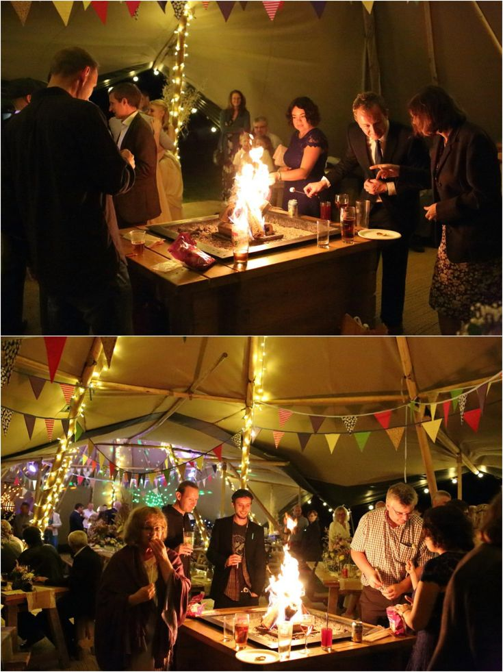 indoor fire and toasting marshmallows at suffolk tipi wedding