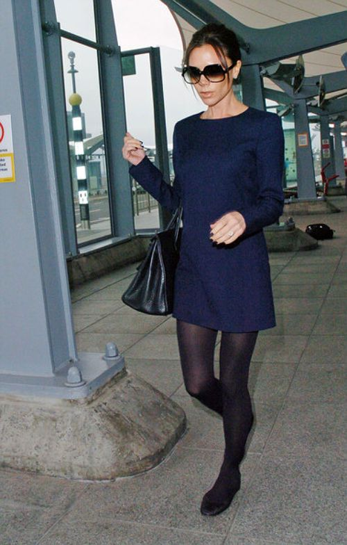 navy mini dress with black tights and black ballerinas plus the only picture of Victoria without.... heels?!