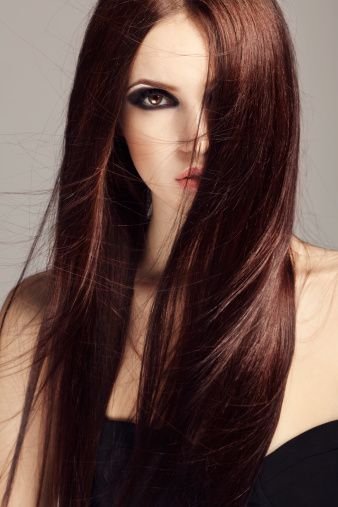 The definition of a deep, rich, chocolate brunette! Looks brown with just a hint of red. www.gmichaelsalon.com