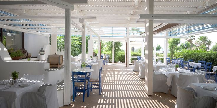 A traditional courtyard house painted in blue and white tones hosts the a la carte restaurant of Zephyros.