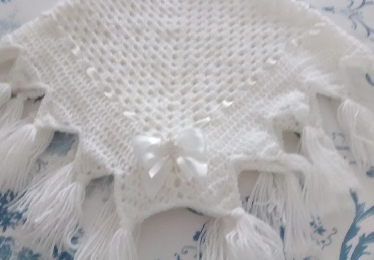 a Jester shawl I crocheted. It is gorgeous made up. pattern from smudgers designs on Etsy