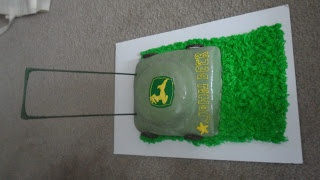 Lawn Mower cake for my nephew's birthday- covered in fondant with buttercream icing grass and handmade/piped decorations.