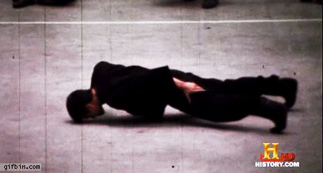 Bruce Lee performing his two finger push up!