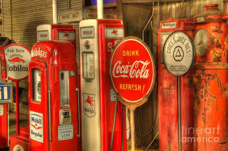 Vintage Gasoline Pumps With Coca Cola Sign Photograph