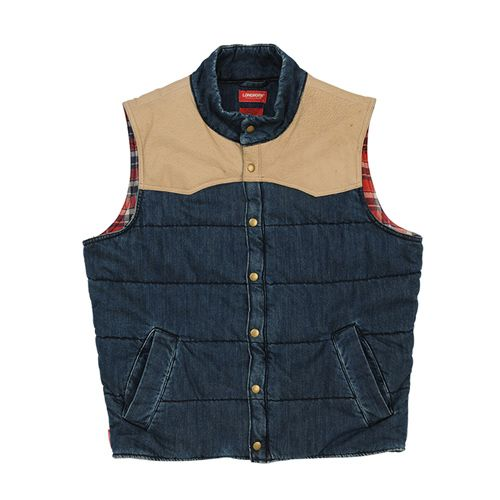 A fun, casual vest, the Longhorn Pelton vest is made from quality 10.5oz denim with genuine leather trim. Tastefully lined with a classic checked cotton, the vest features horizontal quilting, a centre zip and press stud closures, various pockets and a RMW Longhorn flag label in the side seam. Colour: Indigo Blue