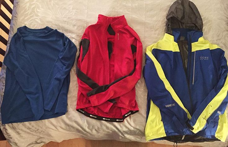 Best Windproof Cycling Jackets: The key to dressing for winter cycling is to wear layers, because cycling warms you up quickly, so you want to be able to peel off layers quickly and easily. Above are 3 layers for the top half of the body: from left, an Under Armor type layer, a warm fleece-lined cycling jersey layer; and over top a great waterproof cycling jacket