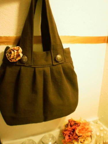 easy diy purse, I would add a large bow and pockets inside. But love the size, longer straps and the gathered front!