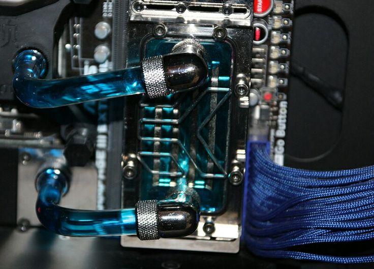 Blue computer PC tower setup liquid cooled case