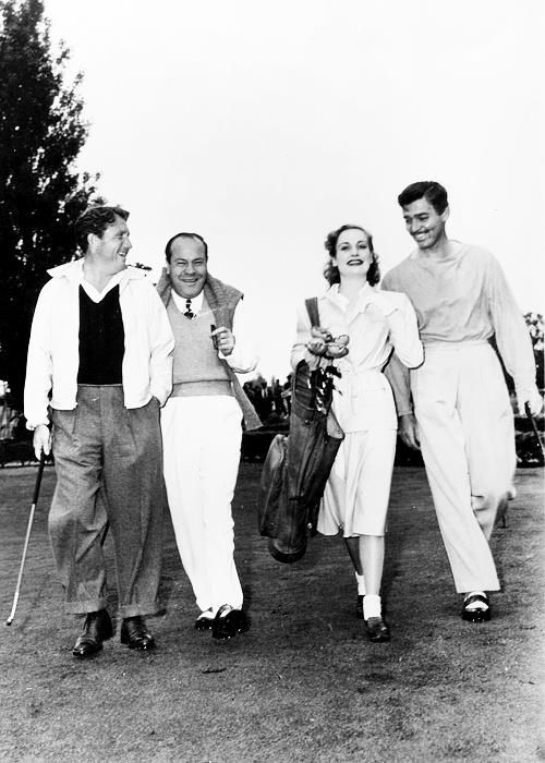 A candid shot of Hollywood legends' Spencer Tracy, Carole Lombard and Clark Gable with notorious MGM studio executive Eddie Mannix, circa 1930s