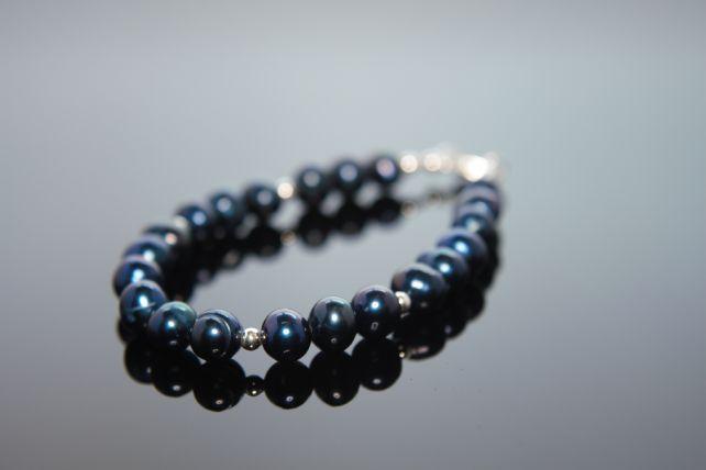 Tethys bracelet.  A classic bracelet of midnight blue potato pearls and silver balls.