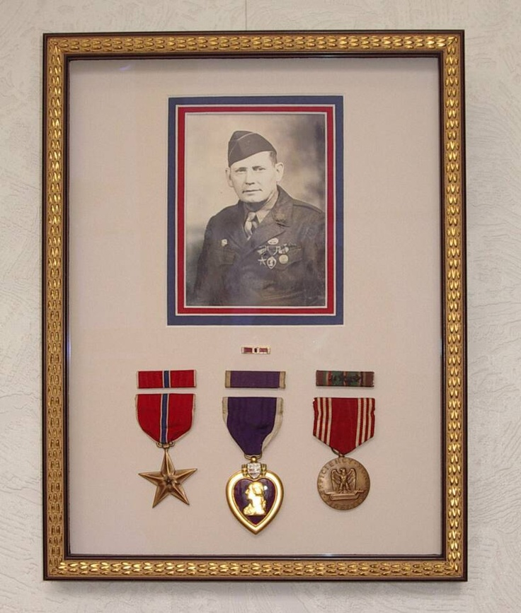 Use shadow boxes to frame old military photos so you can include medals, crew pins, dog tags, shoulder patches, and other memorabilia.