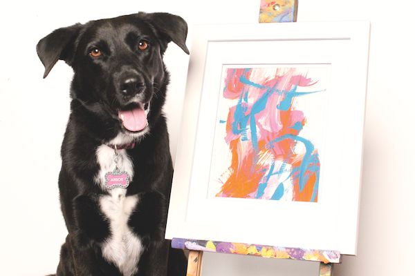 A master! Each one of Arbor's abstract paintings are unique. (Photo courtesy the Henderson family) Proceeds from her art work go to dog charities.