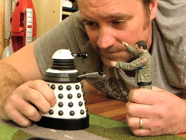 David Hewlett playing with a Rodney McKay action figure and a dalek... Exterminate!!
