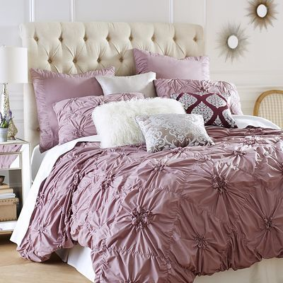 Our ruched Savannah bedding in deep lilac gathers fresh 100% cotton in a pattern of flowers on a field of diamonds. Inside ties at all four corners keep your duvet from shifting, while shams feature tie backs and decorative welting. The ruche is on.