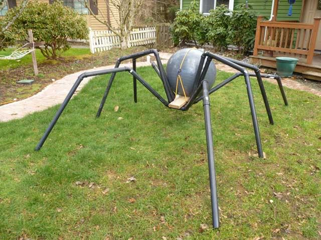 This year, I am adding three giant spiders with tack and riders to my Halloween display.  These giant spiders will be climbing on the roof near the tower with one leaning over the front of the house.  I would like to thank Spider Rider for his guidance in the planning stages of this build.Today, I went to Lowes and bought 50 feet of 1.5 inch drain pipe and a whole bunch of joints.  I also went to Target and bought a 75cm exercise ball for $9.This is the dry run result.Here are a couple of