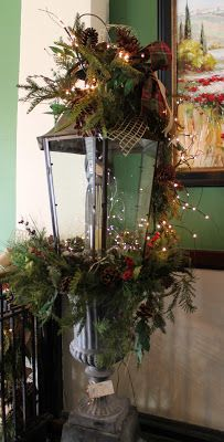 Honeycomb Creative Co.: Nell Hill's at Christmas ,,, great idea ~ lantern atop a garden urn
