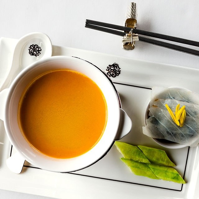 Fusion food reigns in Shanghai; here, organic tomato soup with a side of grouper at The Peninsulas Yi Long Court.