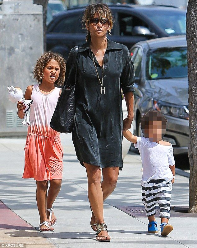 Quality time with the kids: Halle Berry cut a low-key figure in a black shirt dress as she enjoyed an outing with daughter Nahla, seven, and son Maceo, 23 months, in LA, California, on Tuesday