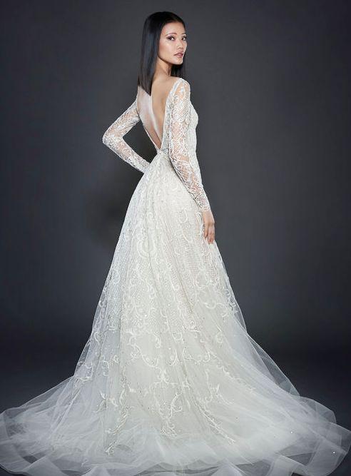 Featured Dress: Lazaro; Wedding dress idea.