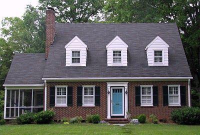 brick house, black shutters, color door