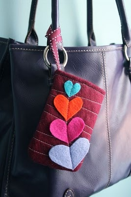 Lovely little phone cozy, with an elastic button closure and gorgeous detailing.
