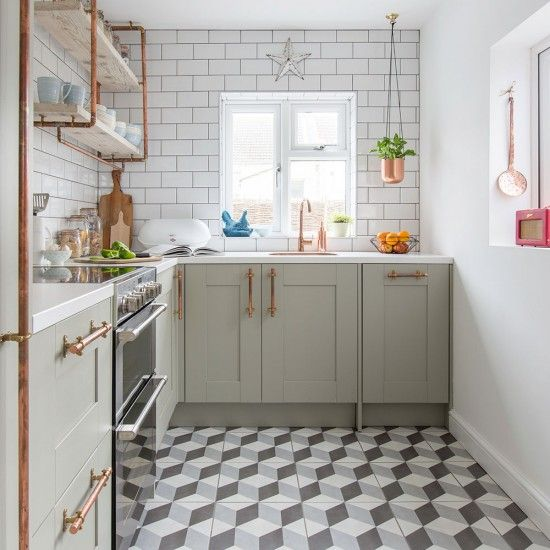 Geometric Kitchen flooring paired with pistachio coloured  doors.